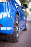 Rear side view of blue sport car Stock Photography