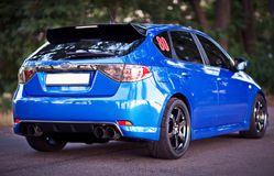 Rear side view of blue sport car Royalty Free Stock Photography