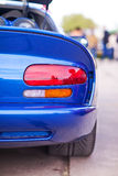 Rear side view of blue sport car Stock Photos