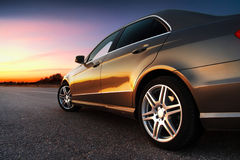 Rear-side view of car. Rear-side view of a luxury car on sunset royalty free stock image