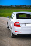 Rear-side view of a car. On nature background Stock Images