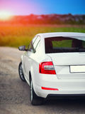 Rear-side view of a car. On nature background Stock Image