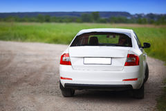 Rear-side view of a car. On nature background Royalty Free Stock Photo