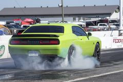 Rear side view of dodge challenger on the track making a smoke show. Napierville dragway super tour, june 2017 Stock Images