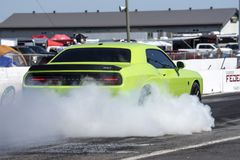 Rear side view of dodge challenger on the track making a smoke show. Napierville dragway super tour, june 2017 Stock Photos