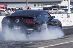 Rear side view of ford mustang making a smoke show. Napierville dragway super tour, june 2017 Royalty Free Stock Photos