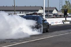 Rear side view of ford mustang making a smoke show. Napierville dragway super tour, june 2017 Stock Image
