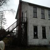 Rear side view old church school house in Enterprise PA royalty free stock photo