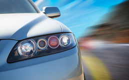 Rear side view of a sport car in blurred motion. A car driving on a motorway at high speeds, overtaking other cars Royalty Free Stock Images