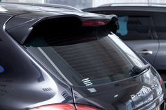Rear Spoiler And Window View Of Porsche Cayenne Diesel  958 2012 In Black Color After Cleaning Before Sale In A Sunny Summer Day Stock Image
