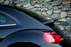 Rear spoiler on coupe car trunk Royalty Free Stock Image