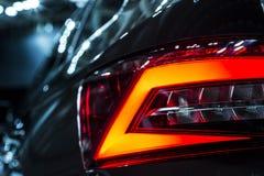 Rear stop light of large suv black car. Rear stop light of car stock photography Stock Image