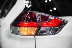 Rear stop light and turn signal of modern crossover car royalty free stock image