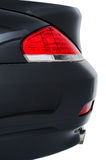 Rear tail light of a modern black car Royalty Free Stock Photography