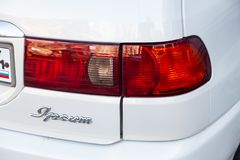 Rear taillight view of Toyota Ipsum 1998 year in white color after cleaning before sale on parking. Novosibirsk, Russia - 04.10.2019: Rear taillight view of stock photos