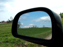 Rear view 1. Rear view on a car mirror, road to hill Stock Photography