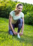 Rear view of active woman running sport shoes Stock Photo