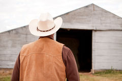Rear view of an African American cowboy. Royalty Free Stock Image