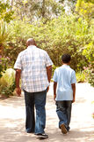 Rear view of an African American father and son taking a walk. Stock Images