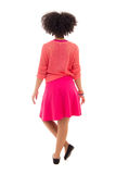 Rear view of african american teenage girl in pink isolated on w Royalty Free Stock Photography