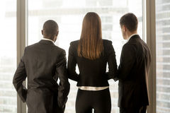 Rear view at african and caucasian businesspeople standing near Stock Photography