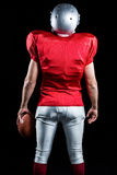 Rear view of American football player with ball Stock Images