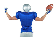 Rear view of American football player holding ball Royalty Free Stock Photos