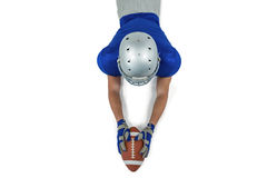 Rear view of American football player reaching towards ball Stock Images