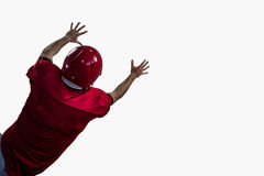 Rear view of american football player trying to catch football Royalty Free Stock Image