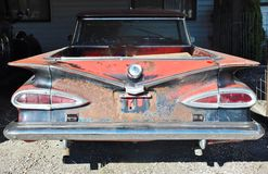Rear view of antique rusty chevrolet  car Stock Images