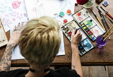 Rear View of Artist Woman Working Painting Flowers Water Color o Royalty Free Stock Photos
