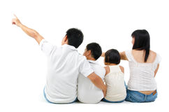 Rear view of Asian family. Looking at side, sitting on white background Royalty Free Stock Photo