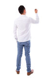 Rear view Asian male writing something. Rear or back view full body picture of an Asian male in white shirt writing something on glass board with marker Royalty Free Stock Photography