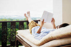 Rear view of asian man relaxing on a sofa Stock Image