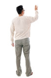 Rear view Asian man touching on transparent virtual screen. Rear view of Asian man hand touching on transparent virtual screen, space for text/button, full Stock Images