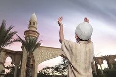 Rear view of asian muslim boy in traditional dress Stock Image