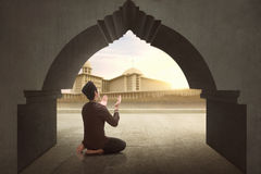 Rear view of asian muslim man praying to god Royalty Free Stock Photos