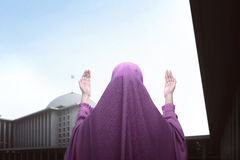 Rear view of asian muslim woman praying. In the mosque Stock Photos