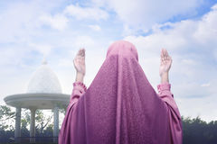 Rear view of asian muslim woman praying. In the outdoor Royalty Free Stock Photography