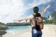 Rear view of asian traveler woman with backpack enjoying the vie stock photo