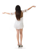 Rear view of Asian woman with white short dress feel free Stock Image