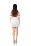 Rear view of Asian woman with white short dress Royalty Free Stock Photos