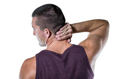 Rear view of athlete with neck pain Stock Images