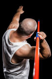 Rear view of athlete preparing to throw javelin Royalty Free Stock Image