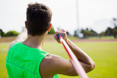 Rear view of an athlete about to throw a javelin. In the stadium royalty free stock photos