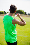Rear view of an athlete about to throw a javelin Stock Photos