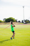 Rear view of an athlete about to throw a javelin Stock Images