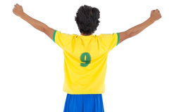 Rear view of athletic football player cheering Royalty Free Stock Photo