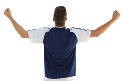 Rear view of athletic football player cheering Stock Photos