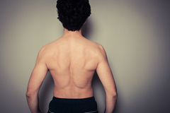 Rear view of athletic young man Royalty Free Stock Photos